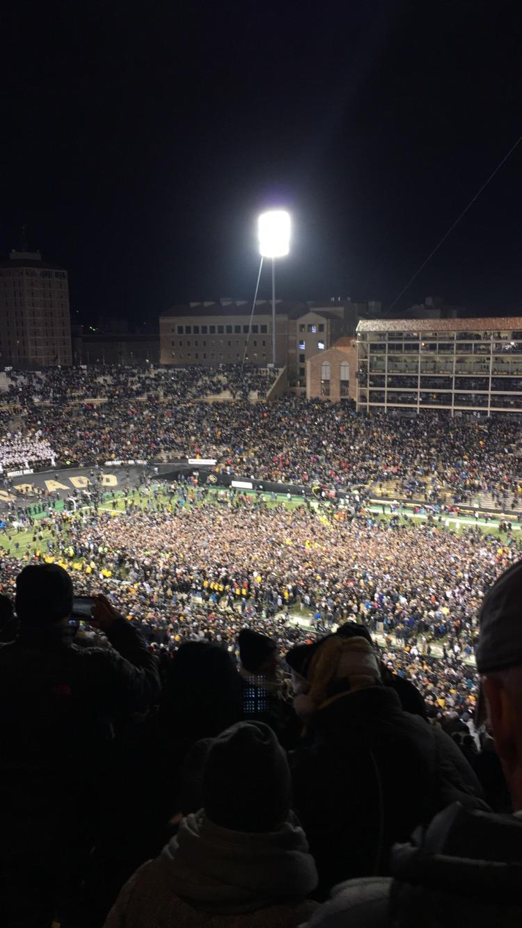 The fans flood onto the field.