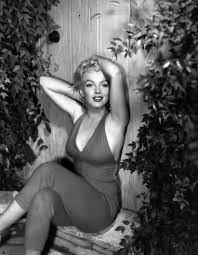 Marilyn Monroe showing off her curves.