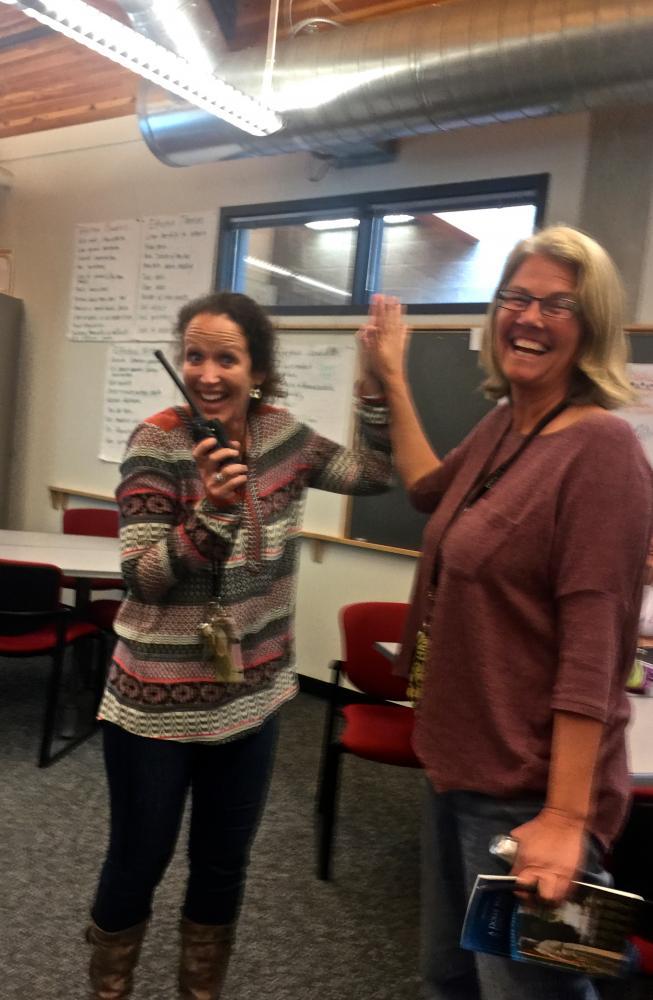 Left: Assistant Principal Sarah Strassburger says hello to co-worker, IB English teacher Cerena Thomsen.