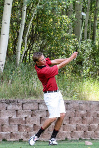 Clayton Crawford tees off on a local course in preperation for the State Golf Tournament.
