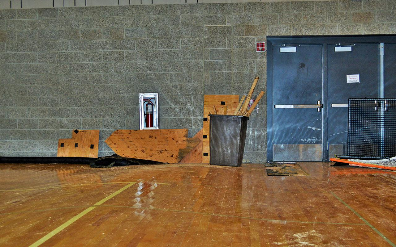 The AHS Gym floor warped, due to flood waters, leaving rest and trough-like impressions.
