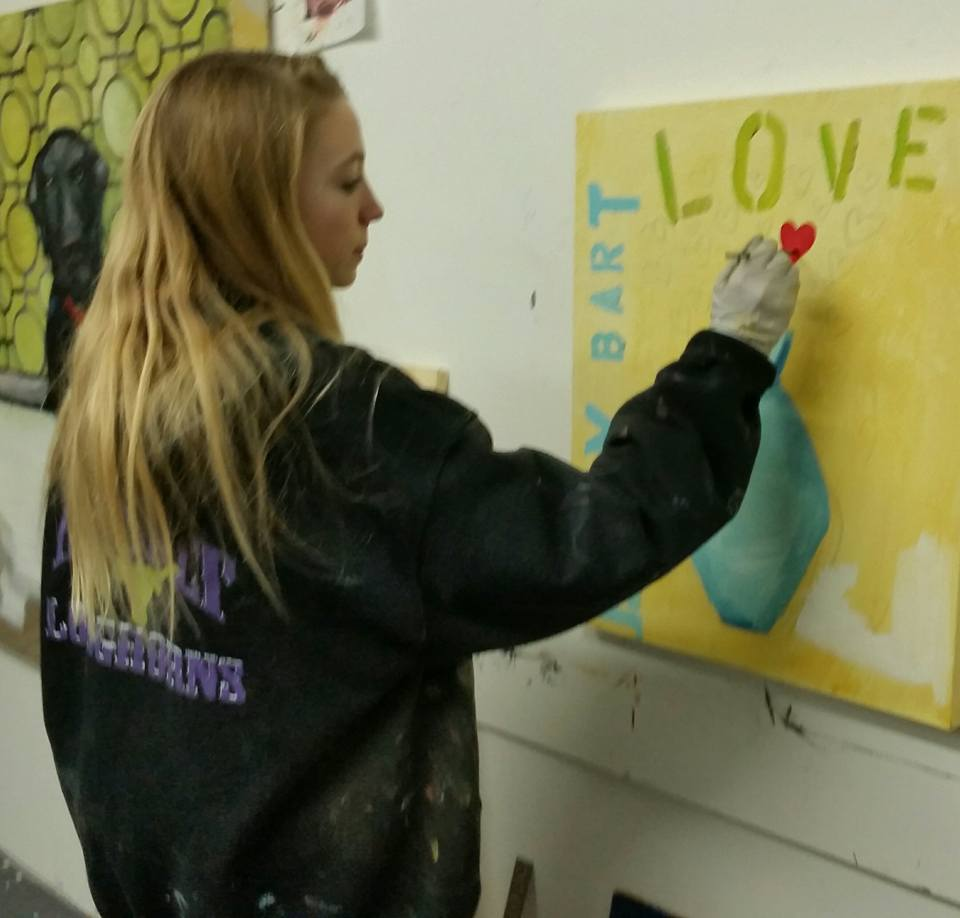 Lily Royer works with Torri Campisi in creating artwork.