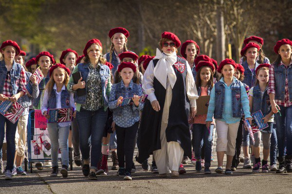 """From left: Claire Rawlins (Kristen Bell), Michelle Darnell (Melissa McCarthy) and the Girl Scouts are determined to sell lots of cookies in the film """"The Boss,"""" that opened April 7."""
