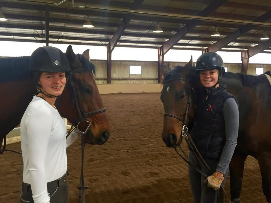 Eloise+Clark+%28left%29+and+Carter+Cheo+%28right%29+pose+with+team+horses+on+a+Sunday+morning%2C+when+practices+are+held.+