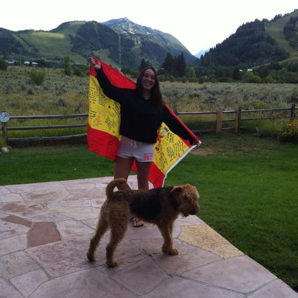 Rotary+exchange+student%2C+Adriana+Romeo+proudly+holds+up+the+flag+of+Spain.+