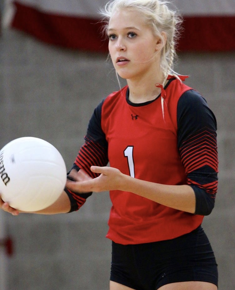 Maddy Bergdahl playing volleyball at AHS