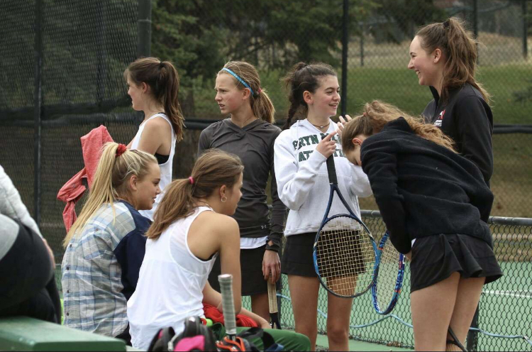 Members of the AHS Girls Tennis Team preparing for the upcoming regional tournament.
