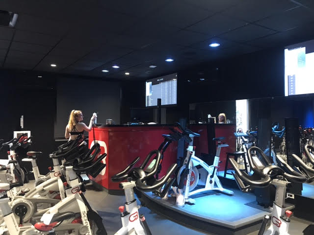 Senior+Sydney+Forster+cleaning+up+after+teaching+a+6%3A30+a.m.+Cyclebar+class+on+Wednesday+April+4th.