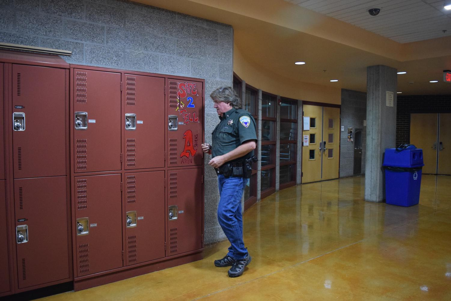 Paul Hufnagle opening the Safe 2 Tell locker at AHS.