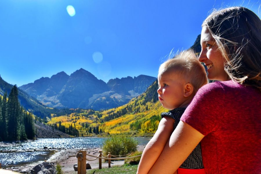 Brittany Hoefert, a new Spanish teacher at AHS, poses with her daughter in front of Maroon Bells.