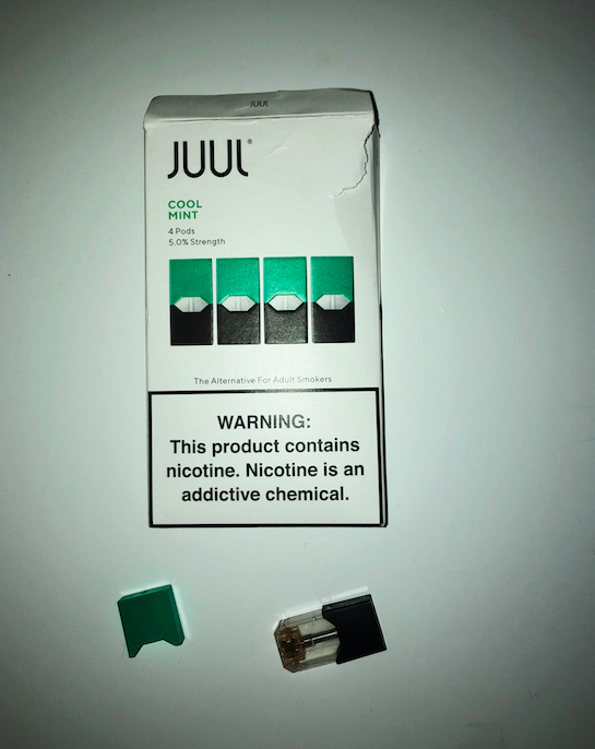 Depicted+above+is+a+package+of+Juul+pods+with+the+company%27s+mission++reading%2C+%E2%80%9CThe+Alternative+for+Adult+Smokers%2C%E2%80%9D+along+with+their+warning+statement%2C+%E2%80%9CWARNING%3A+This+product+contains+nicotine.+Nicotine+is+an+addictive+chemical.%E2%80%9D+Below+the+package+is+a+Juul+%E2%80%9Cpod%2C%E2%80%9D+that+was+found+in+the+girls+bathroom+on+October+4th.%0A