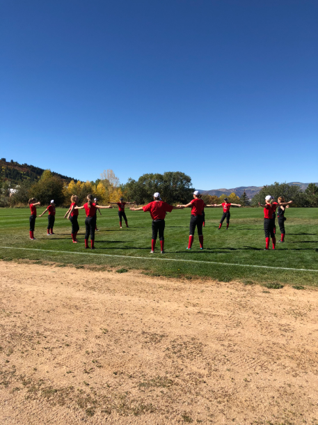 The AHS softball team doing their warm-ups during practice.