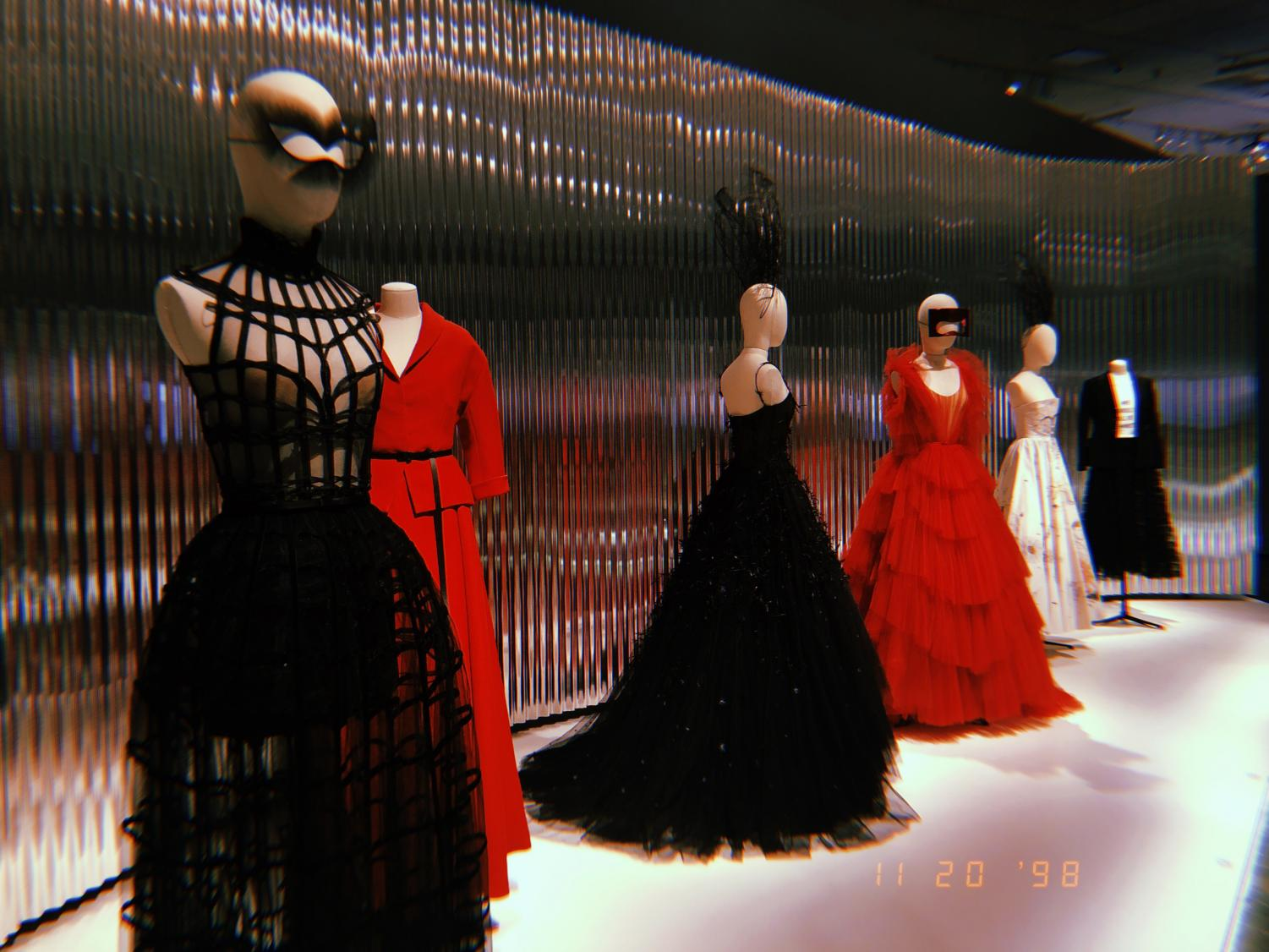 Edgy lineup of red, black, and white couture outfits in the