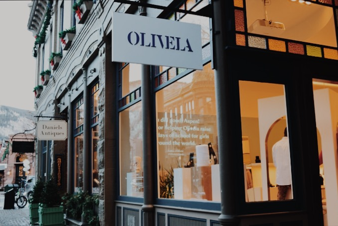 The store front of Olivela on the brick street mall in the late afternoon.