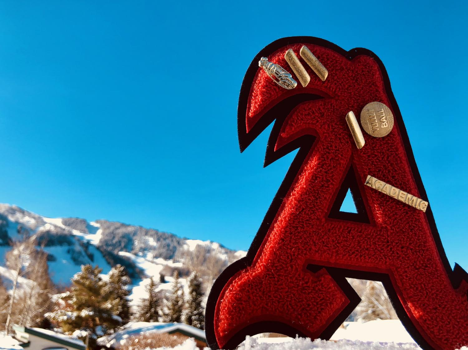 Zoe Guthrie's varsity letter from AHS with Aspen mountain in the background.