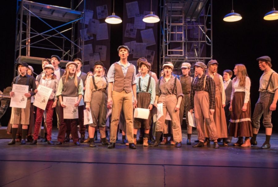Cast+of+Newsies+stands+in+the+finale+after+finishing+their+first+show.