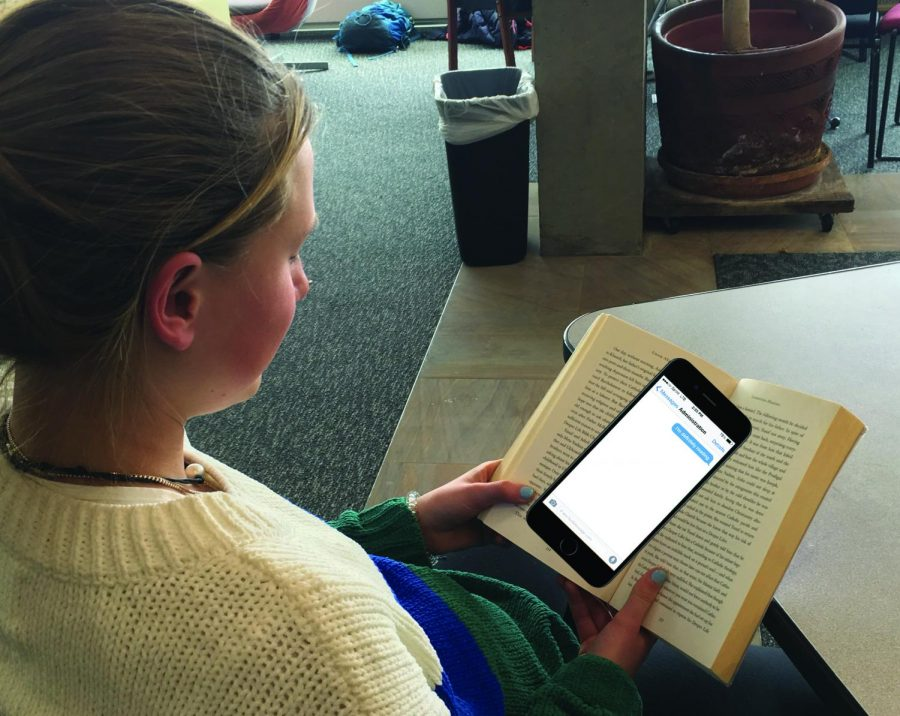 A student studies vigorously as a result of the new phone policy.