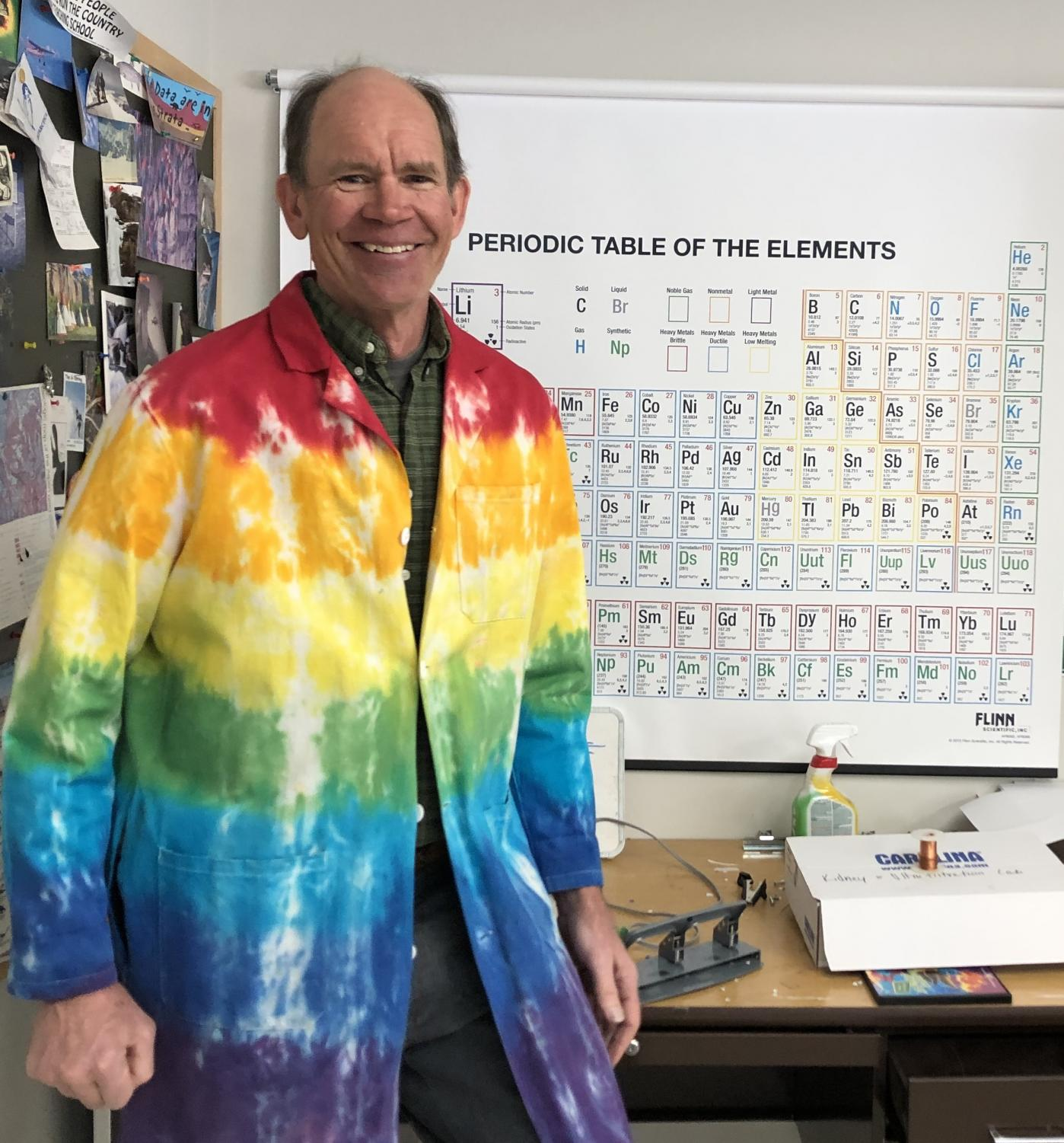 Retiring teacher, Andre Willie, pictured posing in his iconic tie-dye lab coat