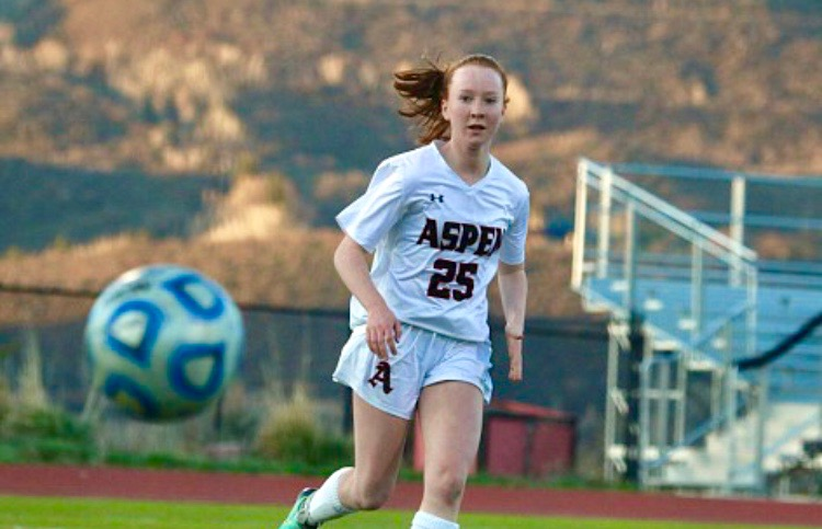 Kelley+Francis+playing+in+an+AHS+varsity+girls+soccer+game+at+the+end+of+her+freshman+season.