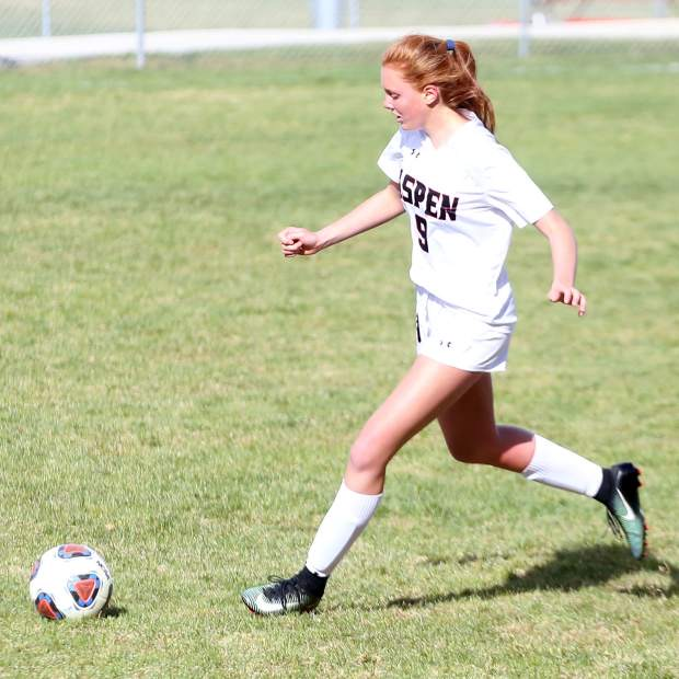 Sophomore Edie Sherlock  pictured playing soccer