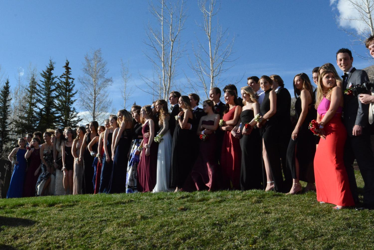 AHS students pose for prom pictures during the golden hour.