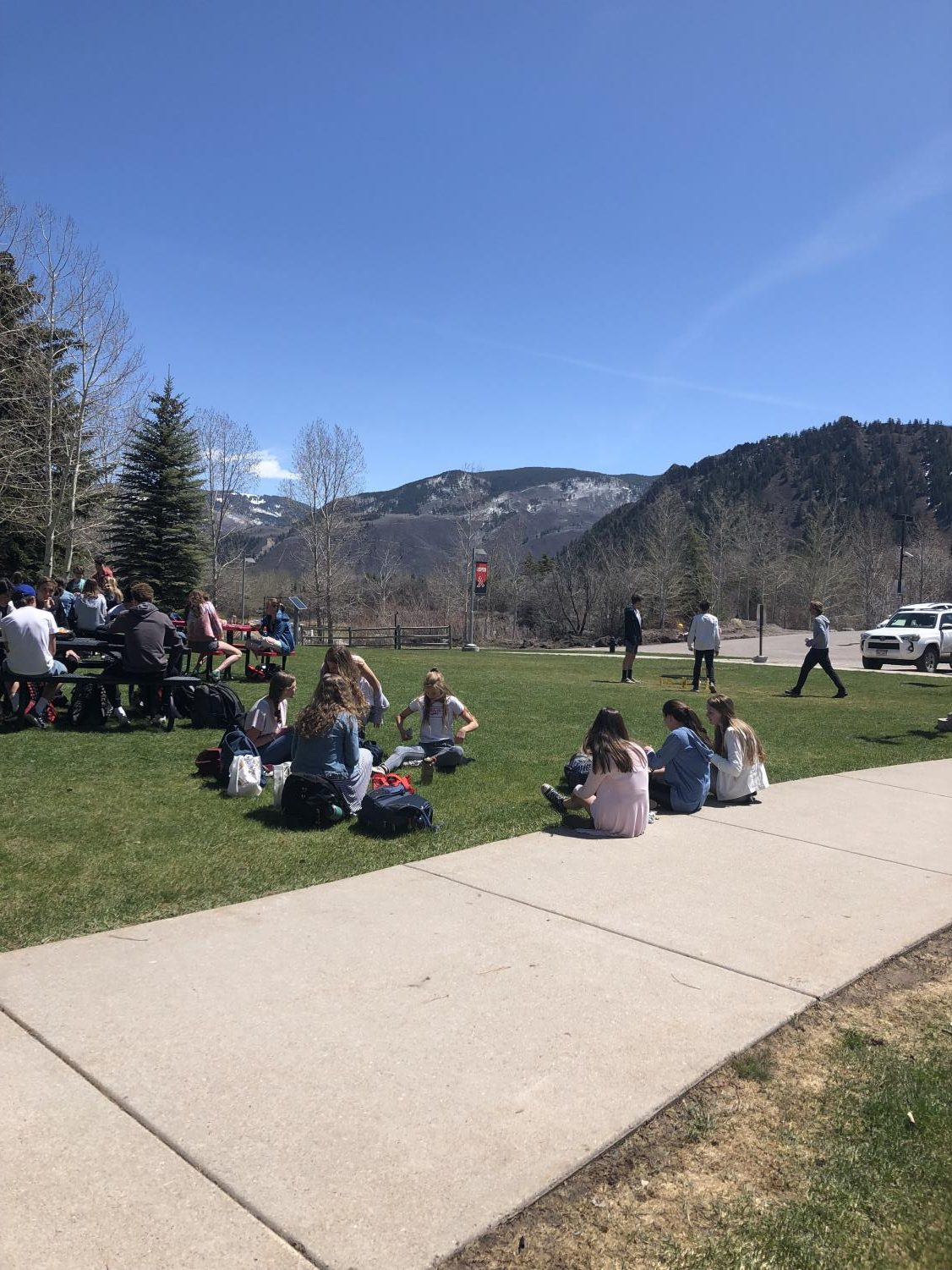 AHS students enjoy sitting outside on the beach at lunch