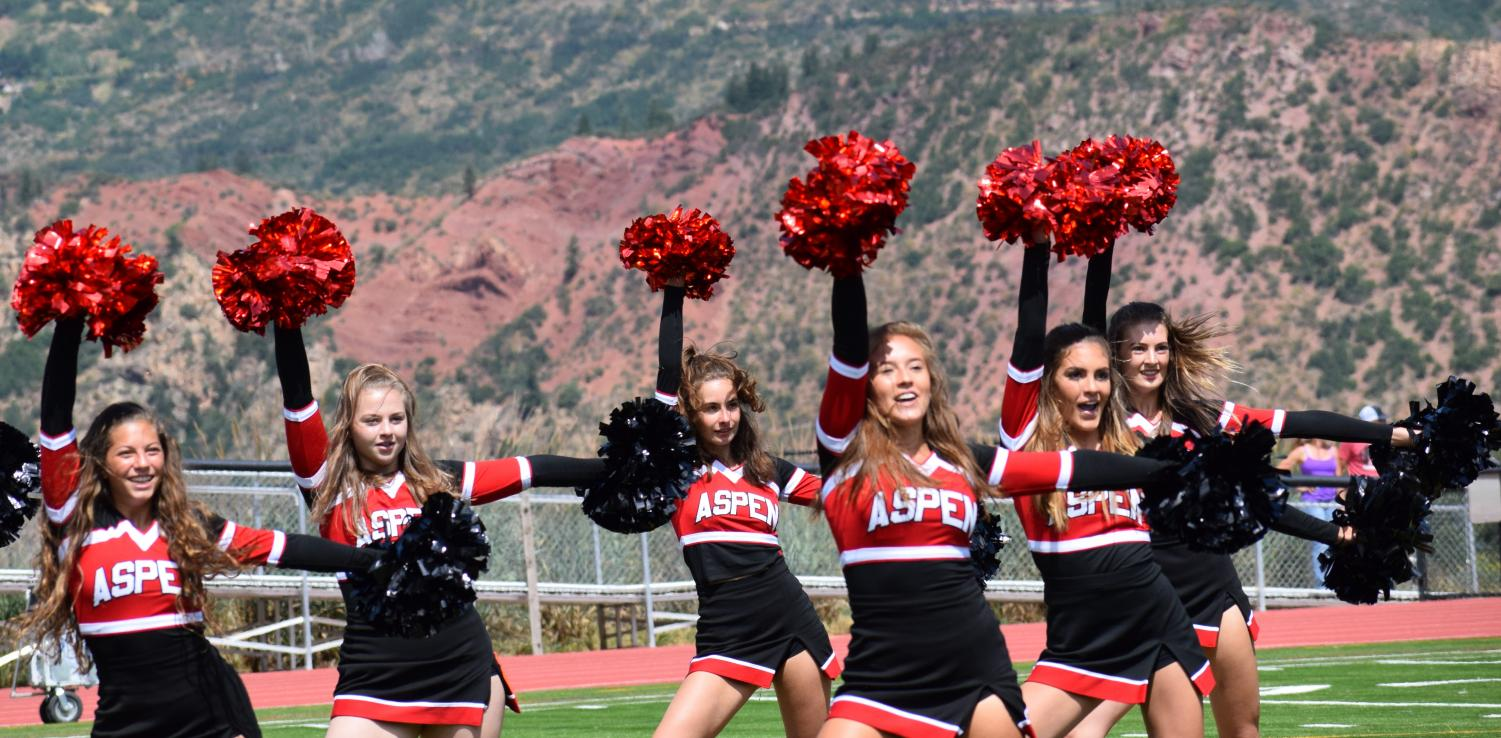 AHS Spirit Team performs during halftime at a football game. Pictured from left to right: Louise Lipsey, Avery Hirsh, Margot Compois, Grace Romero, Jamison Delaney, Eryn Brettman.