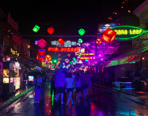 Colorful+lit+street+in+Ho+Chi+Minh+City%2C+Vietnam%2C+after+a+rainy+night.