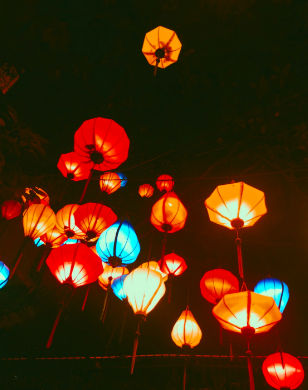 Colorful+lanterns+hanging+above+restaurant+in+Ho+Chi+Minh+City%2C+Vietnam.