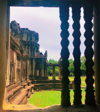 View+of+lush+greens+from+inside+the+temple+ruins+of+Angkor+Wat+in+Siem+Reap%2C+Cambodia.+%0A