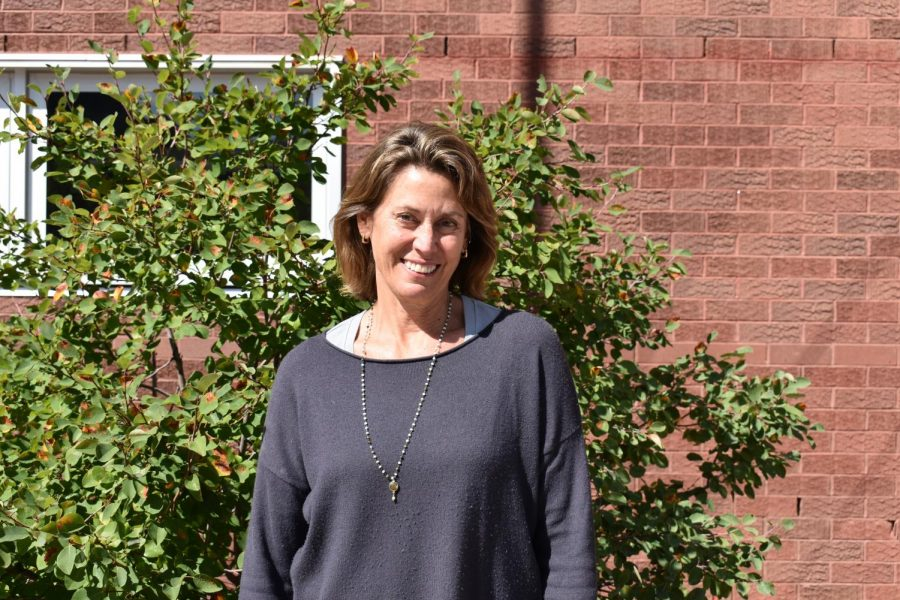 Middle School Principal Elizabeth Meador poses in front of AMS on September 12, 2019.