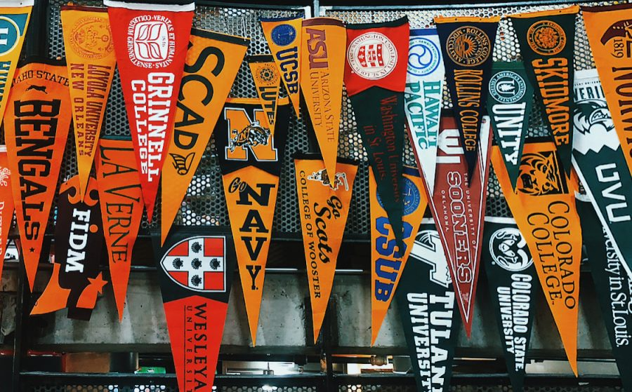 College flags displayed in the Aspen High School cafeteria in the week leading up to College Fair.