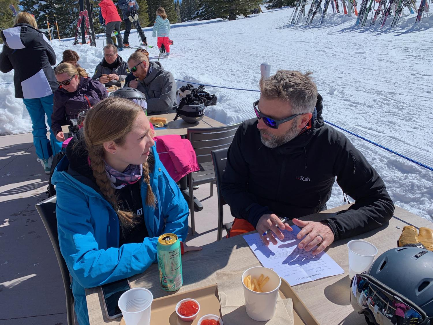 Charlie Laube discussing college with Rachel Devlin on the slopes.