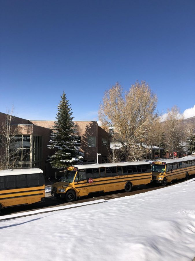The fleet of AHS school busses, waiting to pick up students after school.