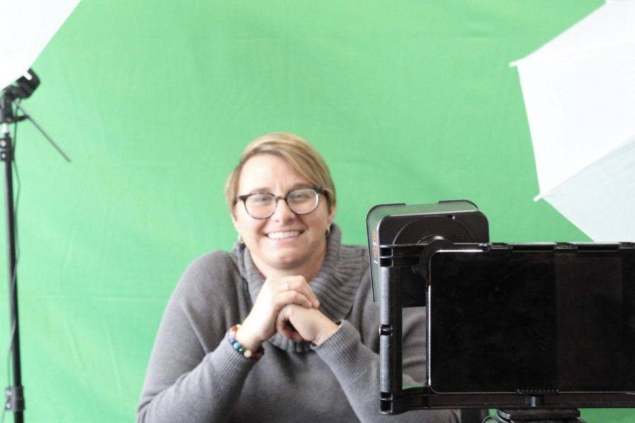Kim+Zimmer%2C+the+AHS+Technology+Integration+Specialist%2C+poses+in+front+of+broadcast+equipment