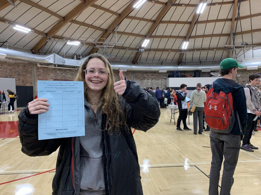 Junior Maggie Woodrow learns about possible IB classes at the IB Fair on Febuary 4th.