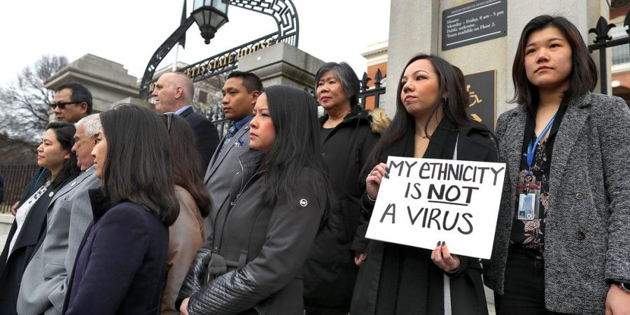 Members of the Asian-American Commission on the steps of the Massachusetts State House protesting the racism toward Asian-Americans as a result of COVID-19.