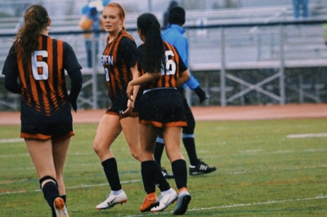 AHS 2020 Women's Soccer Seniors, Karen Galvan-Sanchez, Payton Curley, and Maeve McGuire playing in a home game last Spring.