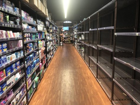 Photo of empty shelves at the Clark's grocery store