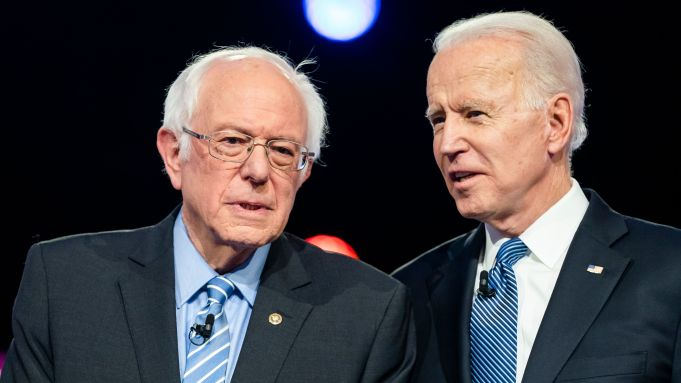 Bernie Sanders and Joe Biden having a conversation.