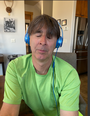 Local Tim Reed listening to music during quarantine.