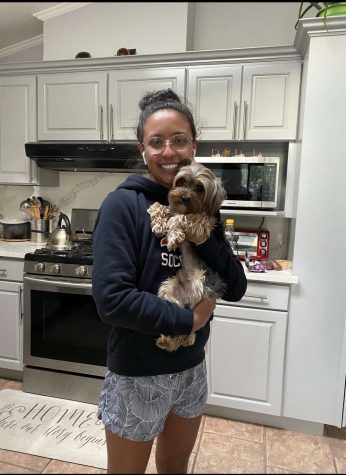 Karen Galvan holds her Yorkie Terrier, Mango, in her house during quarentine.