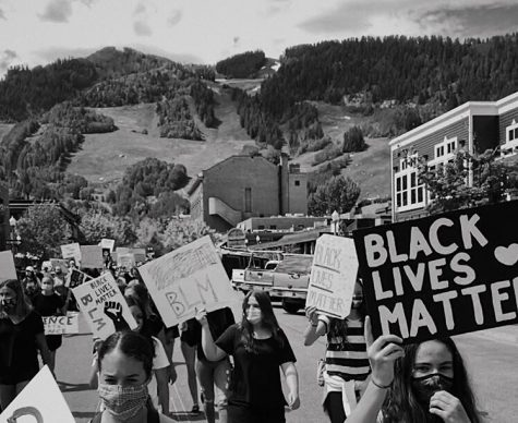 Local protestors marching in the streets to support Black Lives Matter.