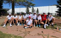AHS boys tennis team poses for a photo after their winning matches against Vail.