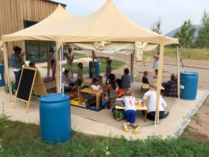 Students at Aspen Community School learning outside on campus as part of the Hybrid Learning Model that has been implemented at ACS and AES.