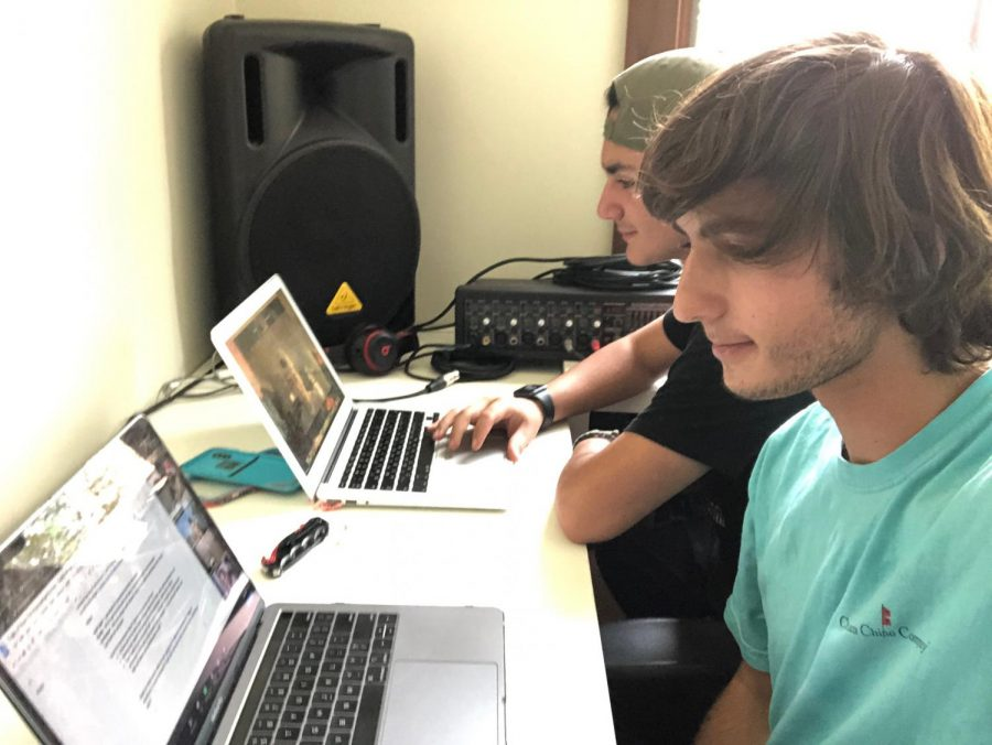 Elijah Goldman (front) and Lian Lilah sit together while doing online school.
