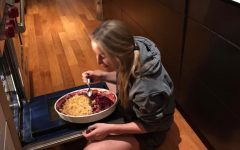 AHS student Gemma Hill enjoying eating a pie