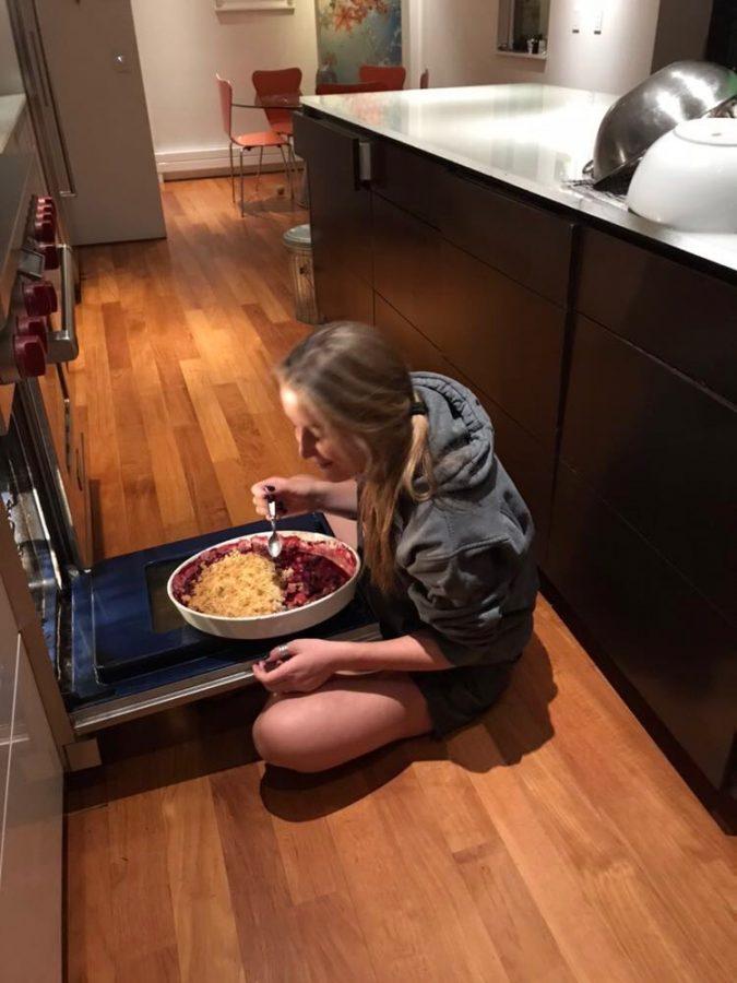 AHS student Gemma Hill enjoying eating a pie