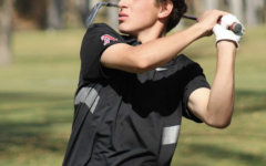 Nic Pevny at the end of his golf swing during the state championship tournament.