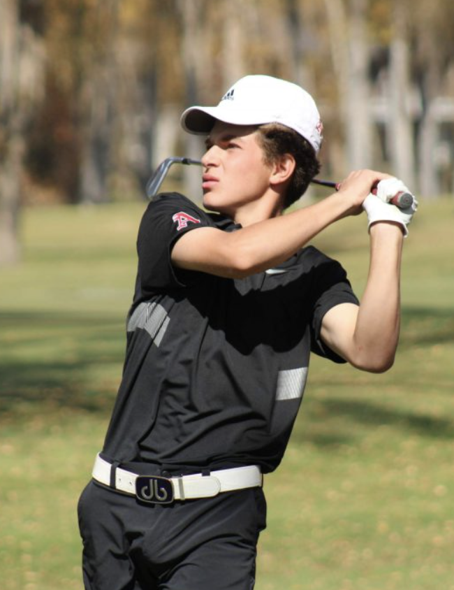 Nic+Pevny+at+the+end+of+his+golf+swing+during+the+state+championship+tournament.